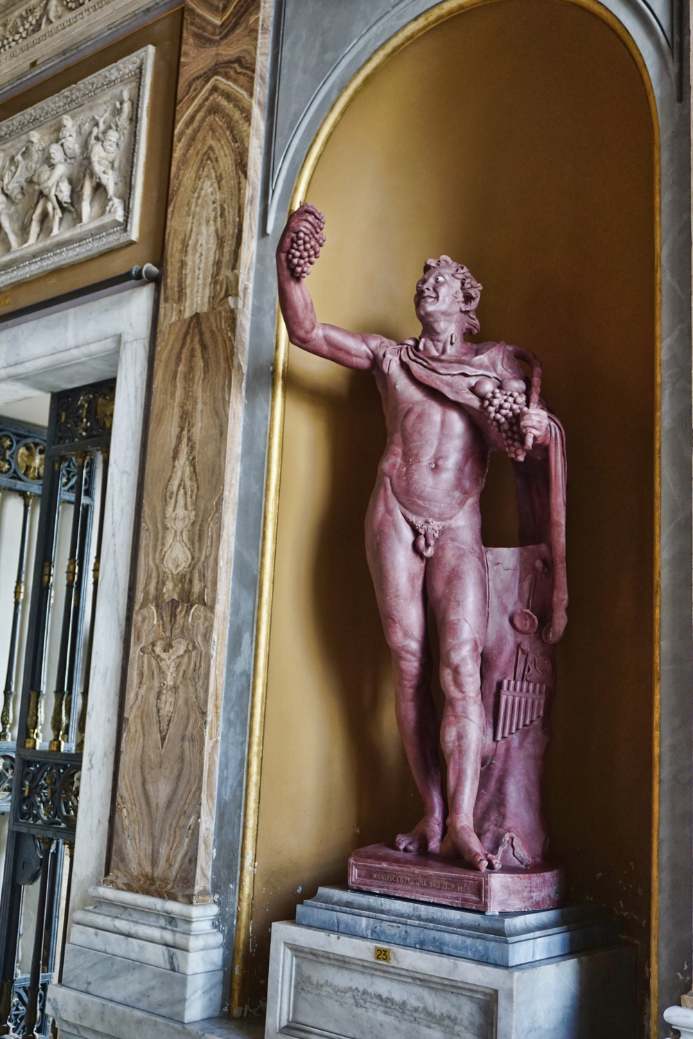 Red Marble Roman Statue