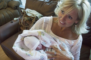 Mimi is happy holding Reed!